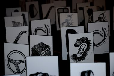 The drawings were displayed on the floor in the entranceway to the exhibition